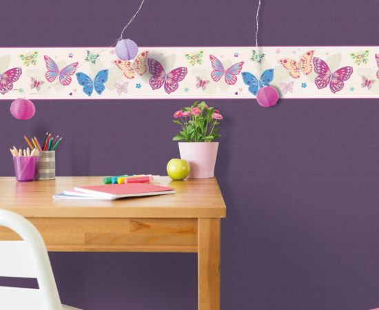 Colorful children study room with wooden desk and magnetic board